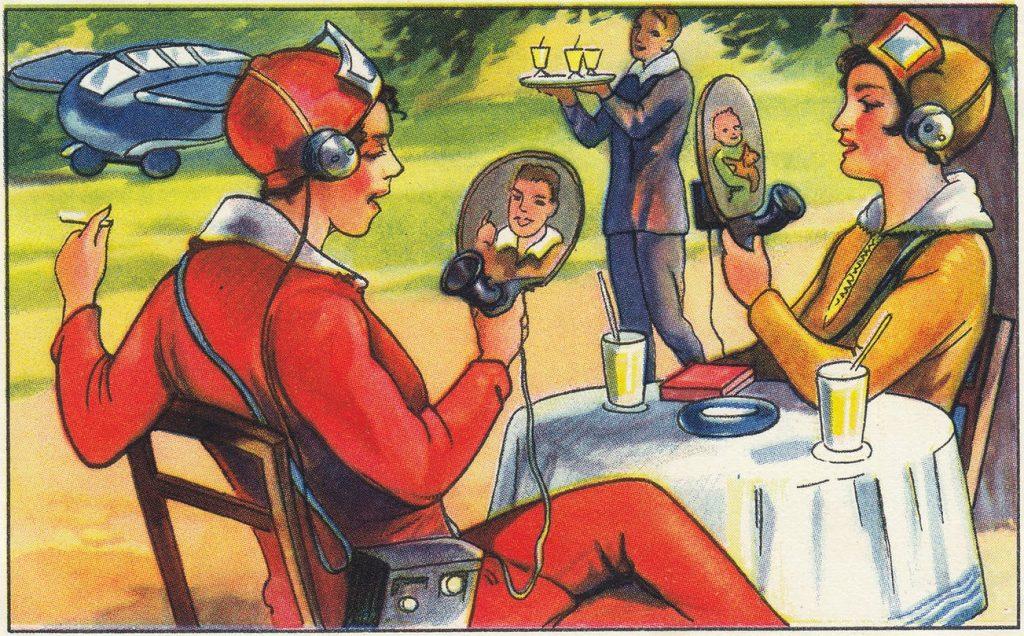Frauen mit mobilen Video-Telefonen im Cafe - aus dem Jarh 1930